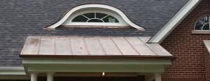 Copper standing seam shed roof over front door